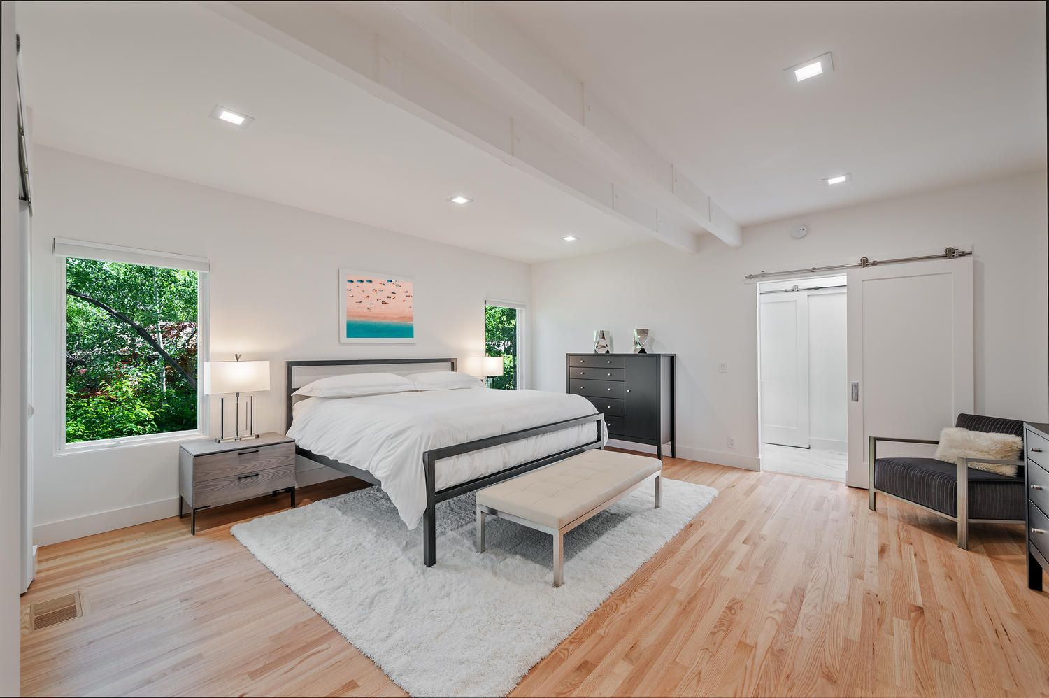 Light and airy primary bedroom after remodel