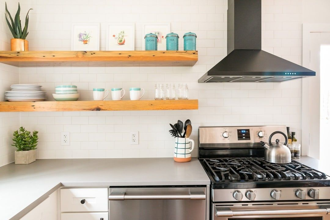 Catskills cabin kitchen with floating shelves after remodel